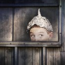 bigstock-Boy-in-a-tin-foil-hat-peeking-smaller-40667101