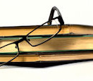 books_and_glasses_shutterstock_35840584.jpg_maria_skaldina_blogsize