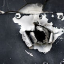 bullet_hole_shutterstock_27005902_by_Nick_Schroedl