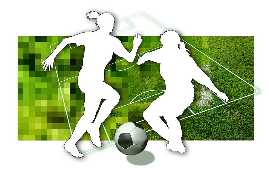 women soccer dribbling