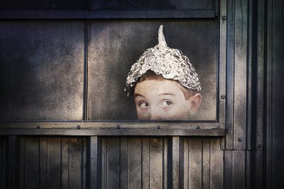 bigstock paranoia boy in tin hat