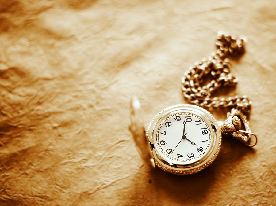 bigstock-pocket-watch-on-old-paper-back-12357476.jpg